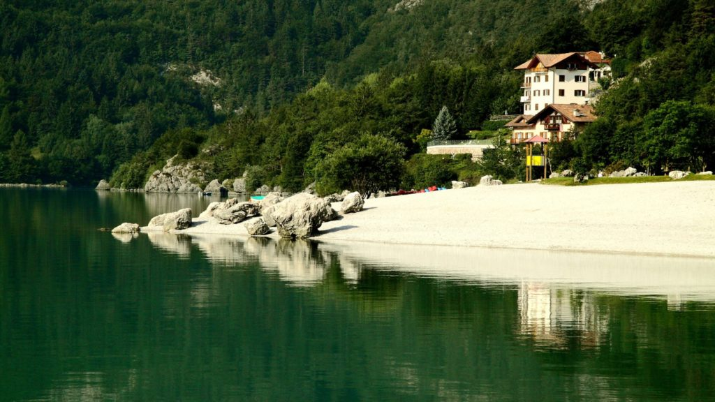 White-sand-beach-of-Alpine-lake